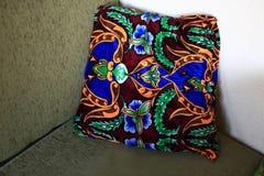 Cushion on sofa. Colorful cushion on green sofa in uzbek restaurant royalty free stock images
