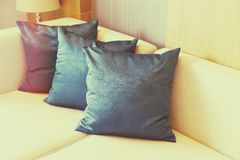 Cushion. On sofa at home stock photos