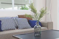 Cushion on sofa. At home stock photos