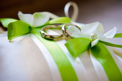 Cushion with wedding rings Royalty Free Stock Photo