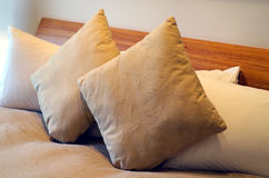 Cushions on a bed Royalty Free Stock Photos
