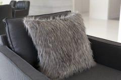 Cushions on black leather sofa Royalty Free Stock Photo