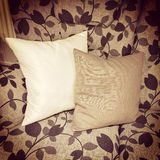Cushions decorating a sofa with floral design Stock Image
