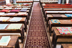 Cushions on empty church benches Royalty Free Stock Image