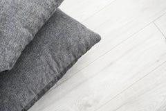 Cushions on floor Stock Photos