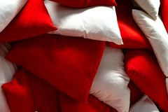 Cushions heaped in heaps. Red and white Cushions