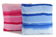 Cushions. Isolated. Two colorful pillows isolated over white Royalty Free Stock Photos