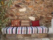 Cushions and kelim on a stone bench Royalty Free Stock Photo