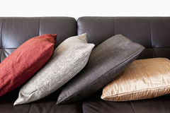 Cushions on leather sofa Stock Photo