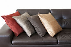 Cushions on leather sofa Stock Photos