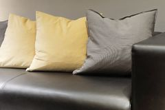 Cushions and Modern Leather Sofa in Living Room Royalty Free Stock Photos