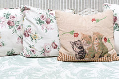 Cushions and pillows on rattan sofa Stock Photography