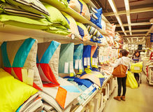 Cushion cushions supermarket retail store shop. Colorful cushions on sale on shelf at home textile department of supermarket. Household goods in store. Cushions stock image