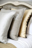 Cushions. Three cushions on a bed royalty free stock photo