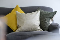 Cushions. Three textured cushions on a grey/blue couch Royalty Free Stock Photo