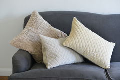 Cushions. Three textured cushions on a grey/blue couch Royalty Free Stock Photos