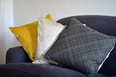 Cushions. Three textured cushions on a grey/blue couch Stock Photos