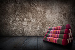 Cushions triangles in plaster walls and old wooden floors. Royalty Free Stock Photo