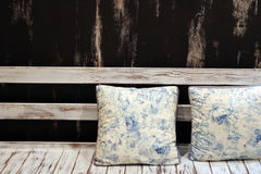 Cushions on a wooden seat Stock Photo