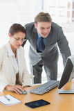 Cusiness couple using computer at office desk Royalty Free Stock Images