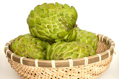 Custard apples in a bamboo basket Stock Photography