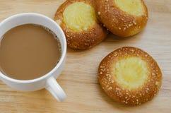 Custard Bun and Coffee for Coffee Break. Custard bun and a cup of coffee for time of coffee break Stock Image