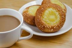 Custard Bun and Coffee for Coffee Break. Custard bun and a cup of coffee for a time of coffee break Stock Photos