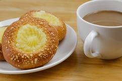 Custard Bun and Coffee for Coffee Break. Custard bun and a cup of coffee for time of coffee break Royalty Free Stock Photography