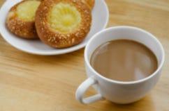 Custard Bun and Coffee for Coffee Break. Custard bun and a cup of coffee for time of coffee break Stock Images