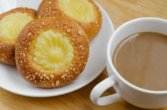 Custard Bun and Coffee for Coffee Break. Custard bun and a cup of coffee for time of coffee break Stock Photos
