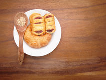 Custard cake and croissant bread on white dish Stock Photography
