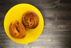 Custard cake on a plate. Custard  cake on a wooden background. cake top view Royalty Free Stock Photo