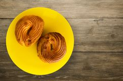Custard cake on a plate. Custard  cake on a wooden background. cake top view Royalty Free Stock Image