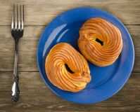 Custard cake on a plate. Custard  cake on a wooden background. cake top view Stock Photography