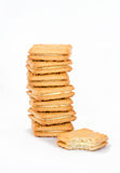 Custard Cream Stack. A stack of Custard Cream Biscuits. One has had a bite taken from it Royalty Free Stock Image