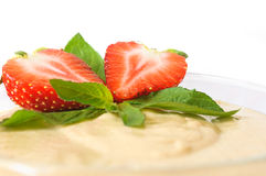 Custard dessert with fresh strawberry and mint. On a white background Royalty Free Stock Photography