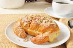 Custard filled almond croissant Stock Image