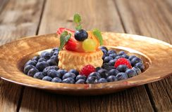 Custard filled puff pastry and blueberries Royalty Free Stock Photo