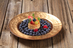 Custard filled vol-au-vent and fresh blueberries Stock Photography
