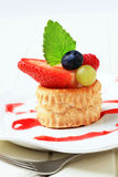 Custard filled vol-au-vent with fruit Stock Photos