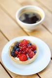 Custard fruit tart and cup of coffee Stock Photo