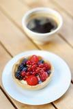 Custard fruit tart and cup of coffee Stock Photo