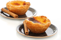Custard Pies with cinnamon sticks Royalty Free Stock Photography