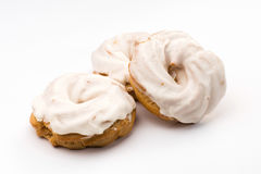 Custard rings in white glaze with cream Royalty Free Stock Photo