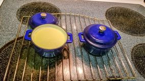 Custard in small blue cast iron serving pot royalty free stock images
