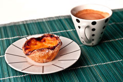 Custard tart and a coffee Royalty Free Stock Image