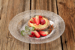 Custard tart topped with fruit Stock Images