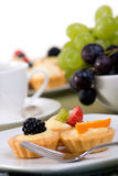 Custard Tarts. Fresh custard tarts topped with fruit and served with a cup of coffee Stock Photo