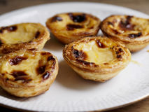 Custard tarts. In a plate with some softfocus Stock Photo