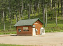 Custer State Park entrance, South Dakota. Custer County, South Dakota--July 2018: Small log coffee cabin at the foot of the mountain at Custer State Park, South stock photo